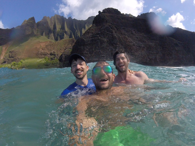 Three men in the water near Kauai