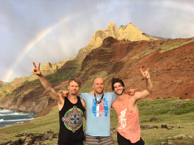 Happy Peter Santenello with two other guys and the rainbow in Kauai