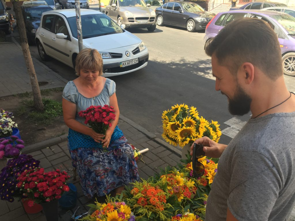 A man buying flowers on the street in Kyiv, Ukraine