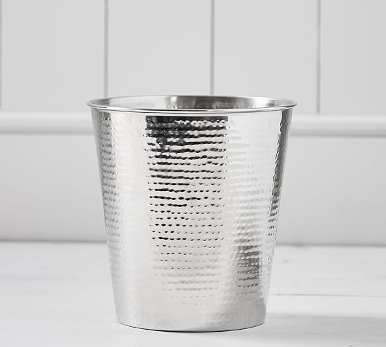 This   Hammered-Nickel Wastebasket   can be found online or in stores at Pottery Barn.