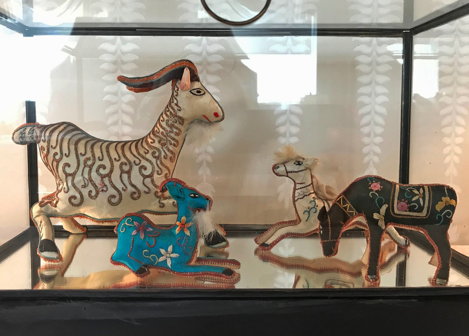 This small collection of antique animal toys resides in my client's guest bedroom. I found these at a local antique shop and I hope she will hunt for more to add to her collection through the years.