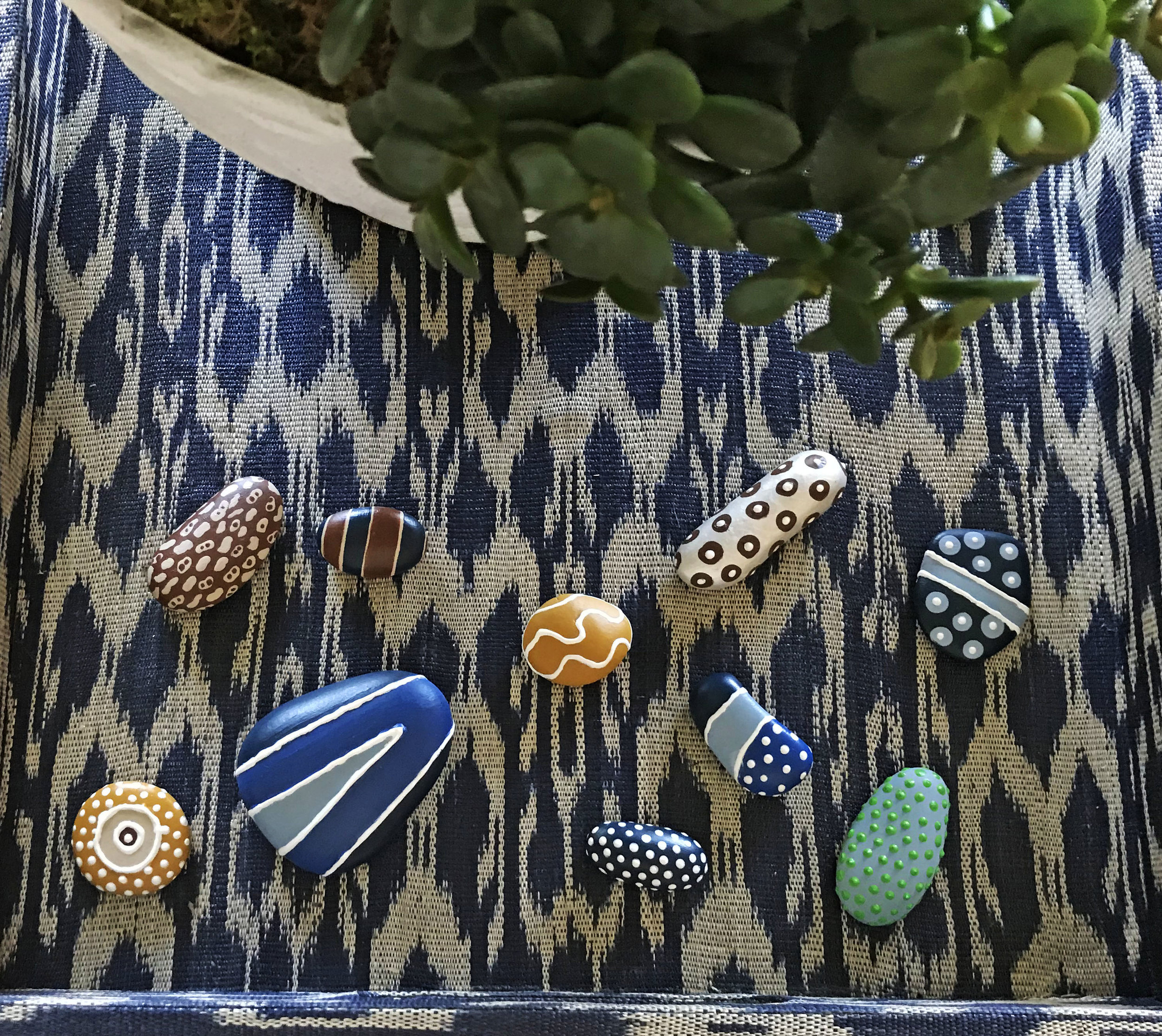 I love this small collection of hand painted rocks. The pattern play makes them an instant curiosity in this tray. Collections are for examining and provoking thought.