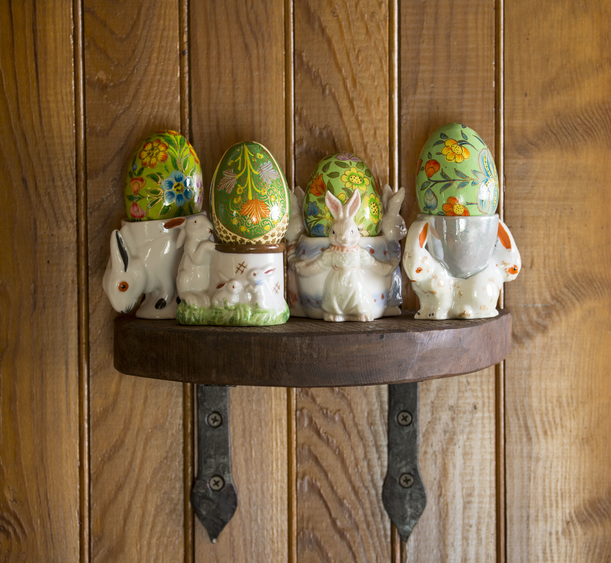 These bunny-themed egg cups and hand-painted Easter eggs were collected for a client whose sweet grandmother went by the nickname Bunny. They are lovingly displayed in a cottage that pays homage to her.   Photo credit John Bessler.