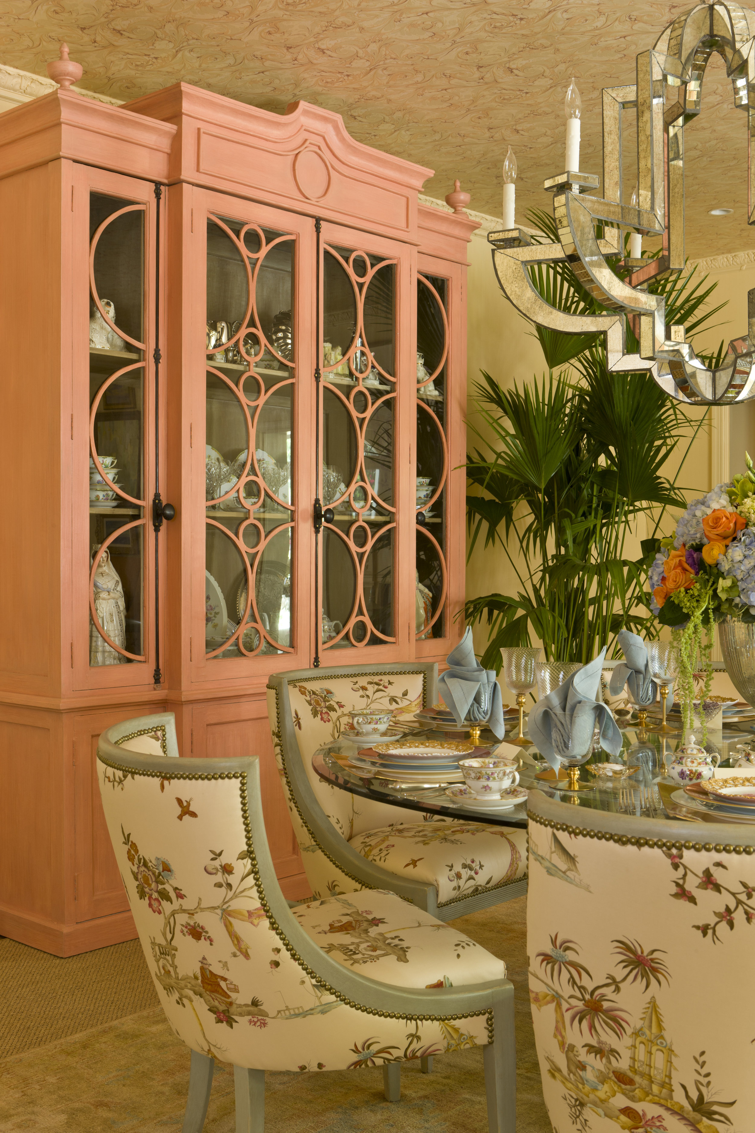 I painted this cabinet coral for a show house dining room to reflect the mood of the space.