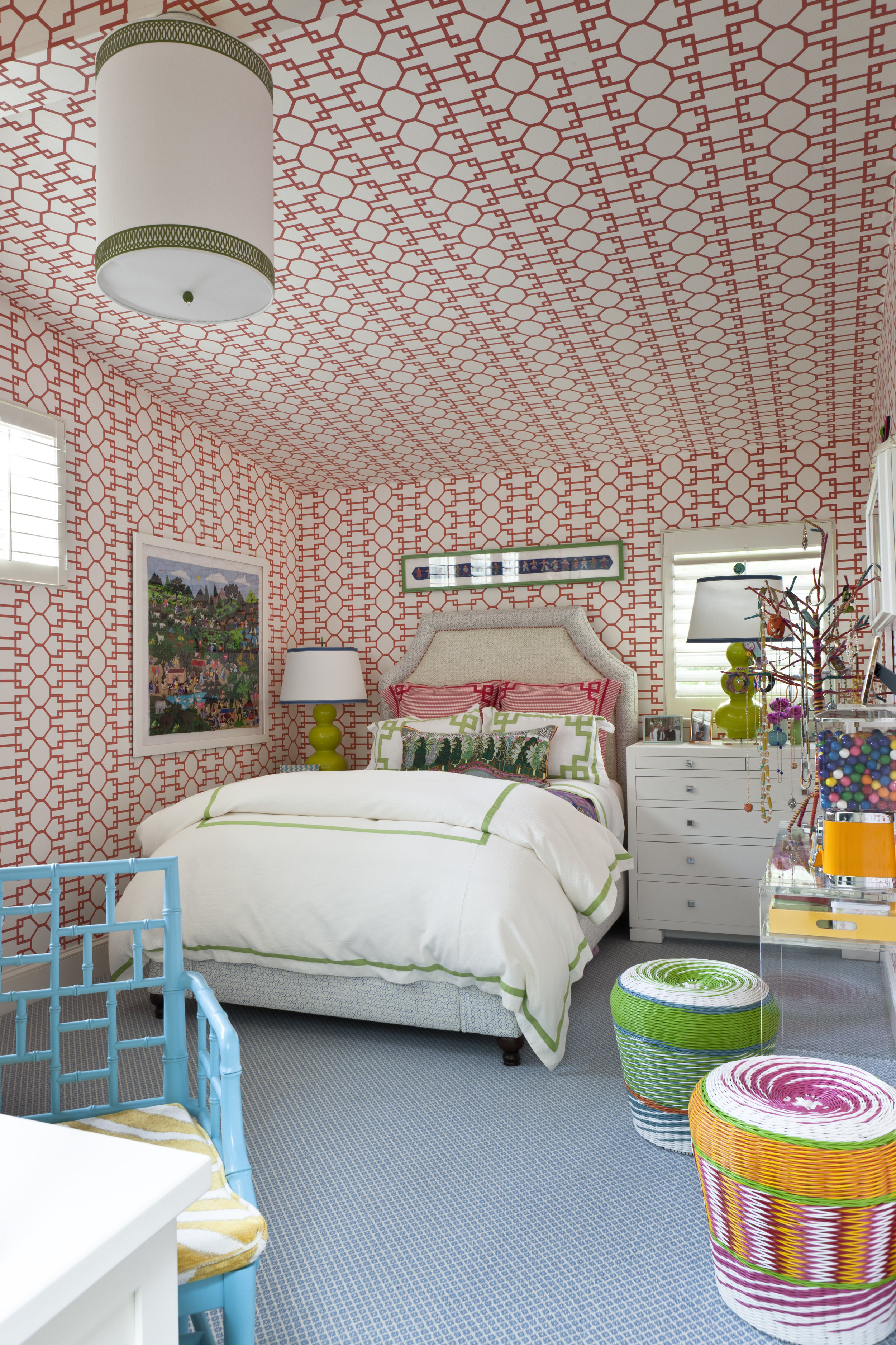 Cool coral geometrics lay the foundation for this young bedroom.