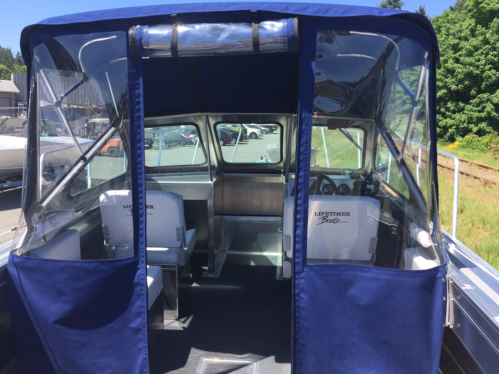 Two piece canvas (this one also has the canvas with roll up door) with similar seats (2).JPG