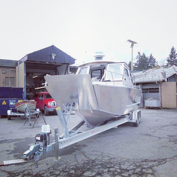 A variation on one of our 2450 Hardtop models as a landing craft from a few years back! You dream it, we build it. Have a good weekend everyone! #lifetimer #lifetimerboats #landingcraft #aluminumboat #boatlife #westcoast #adventure #goanywhere #versatile #pacificnorthwest #quality #boats