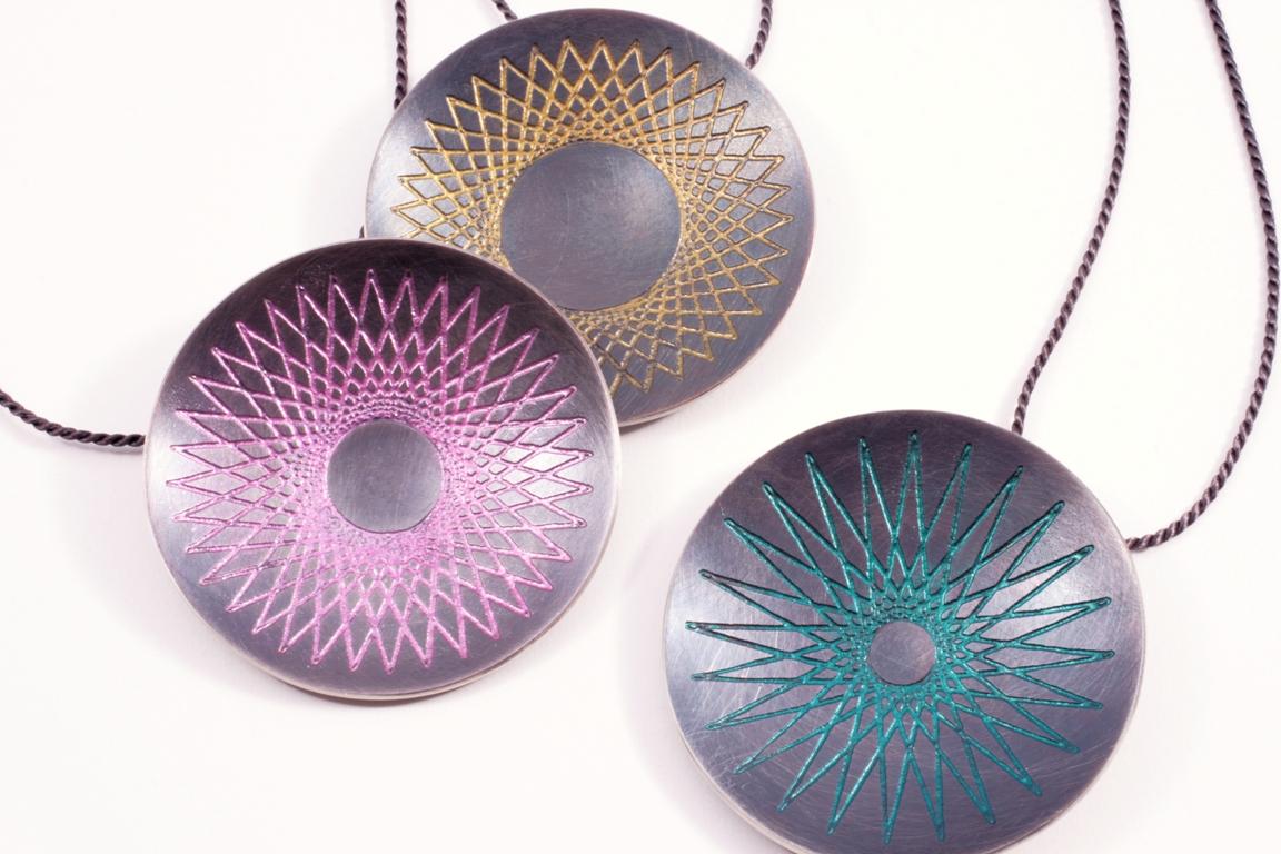 Doris Jurzak, Symmography pendants, 2012, 925 silver, nail polish, silk cord