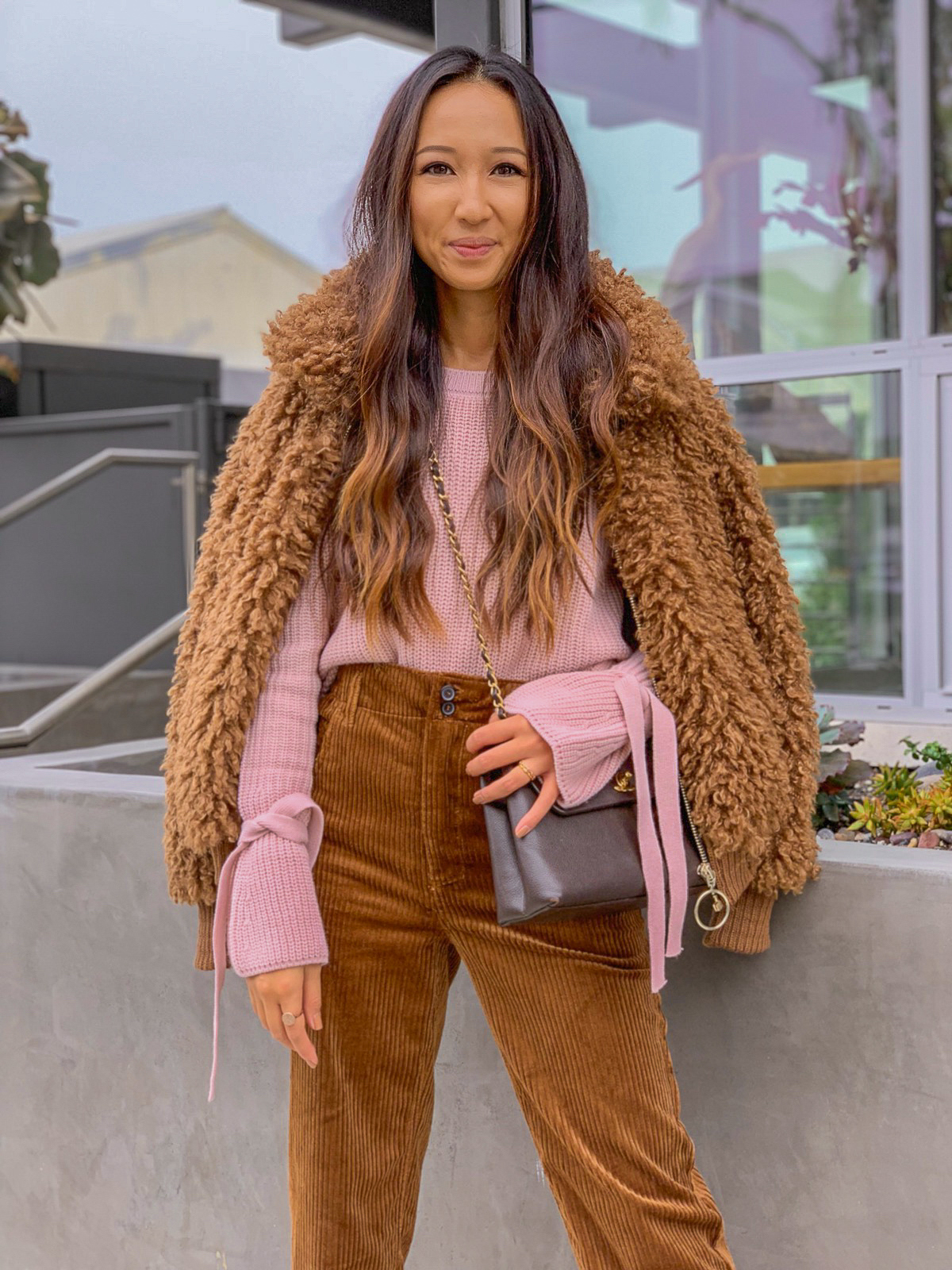 how to wear this teddy bear trend? - Simply, however you fancy.I however love channelling 70 vibes. Think floaty midi dresses, wide leg trousers and ankle boots or platforms.