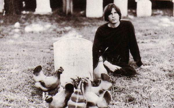 q evan dando at grave with chickens.jpg