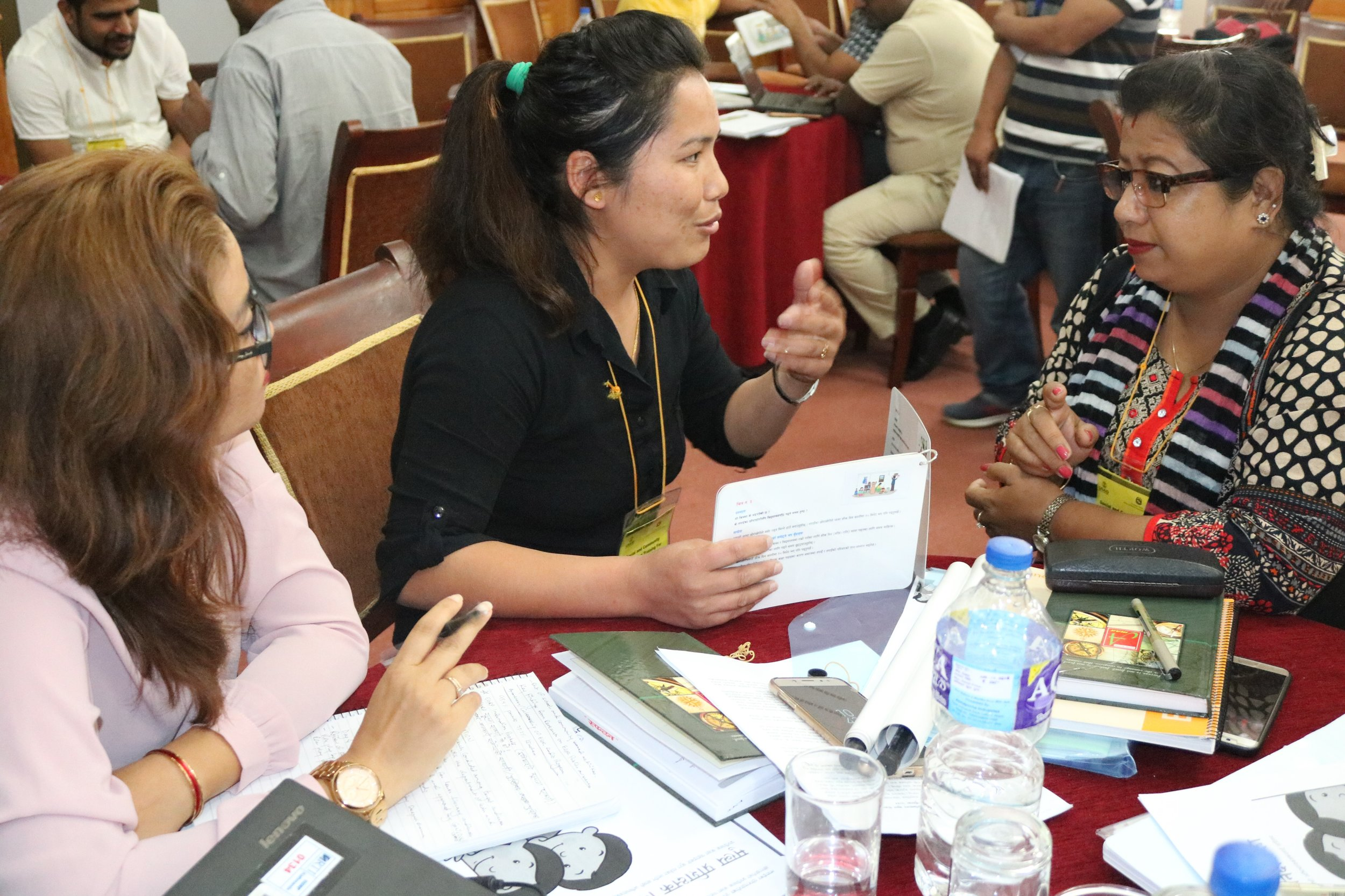 Participants in an Another Option-led training role-playing on social mobilization techniques for early grade reading during a national training in Katmandu, Nepal.