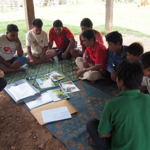 Men studying our initial communication materials.