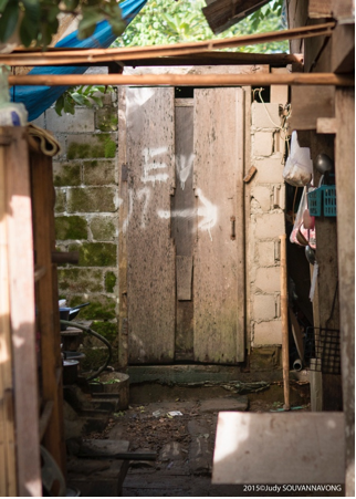 Noy's family latrine was built in early 2014. Neighbors followed suit in their own construction of latrines, significantly raising sanitation standards in the surrounding community. Photograph by Judy Souvannavong.