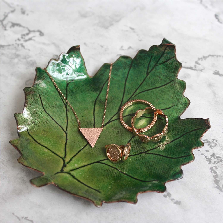 Jewellery on enamel leaf tray by Ashleigh Proud