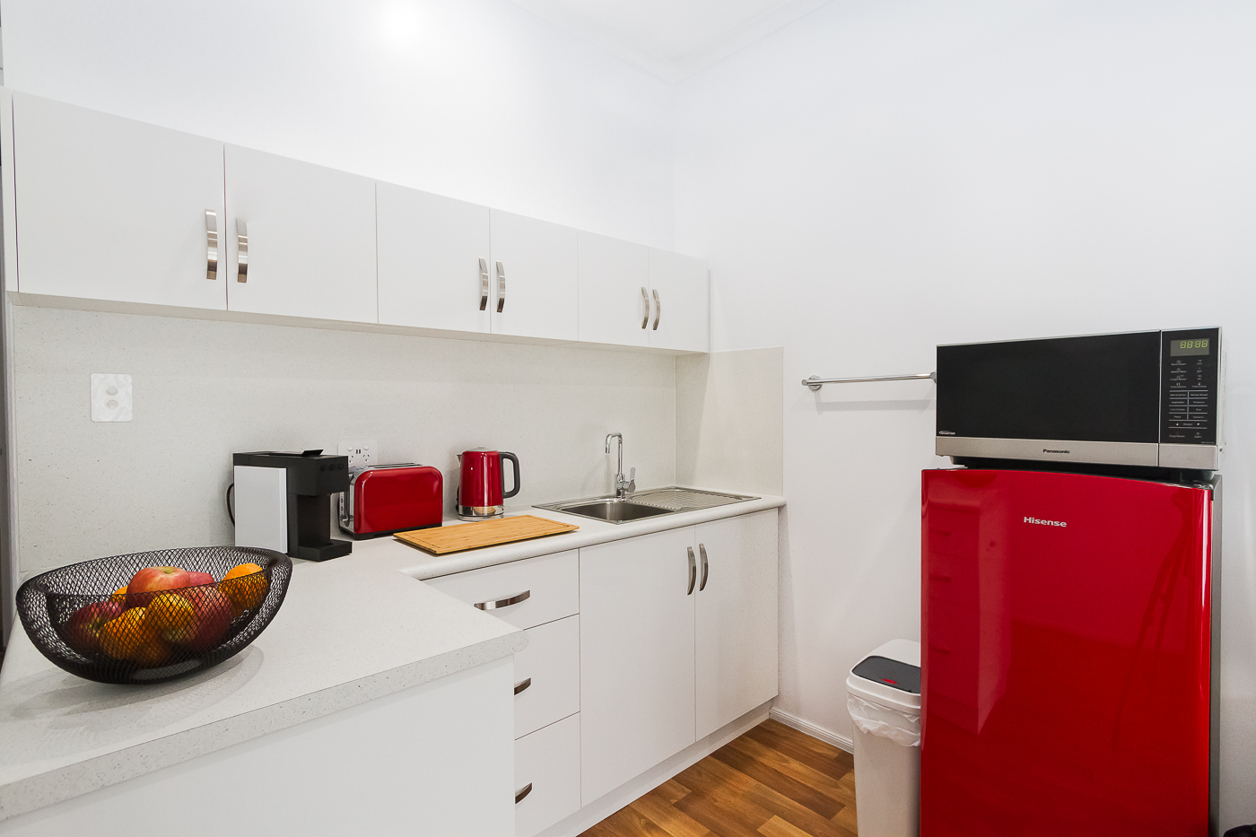full size fridge, microwave, toaster, capsule coffee, quality cutlery, crockery and glassware