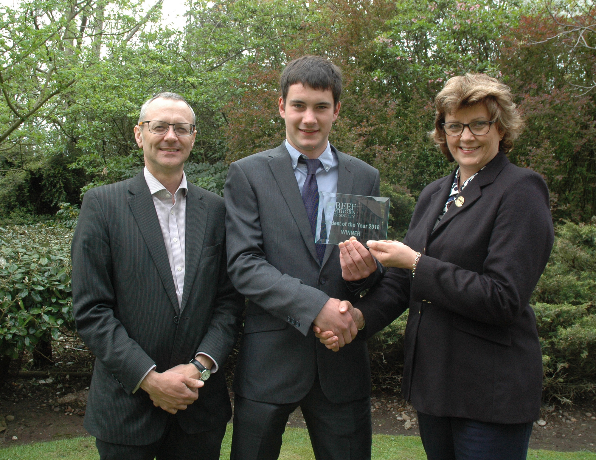 Beef Student of the Year, Henry Scholefield receives his award from Beef Shorthorn Cattle Society president, Sally Horrell, with Course Tutor, Prof Paul Wilson