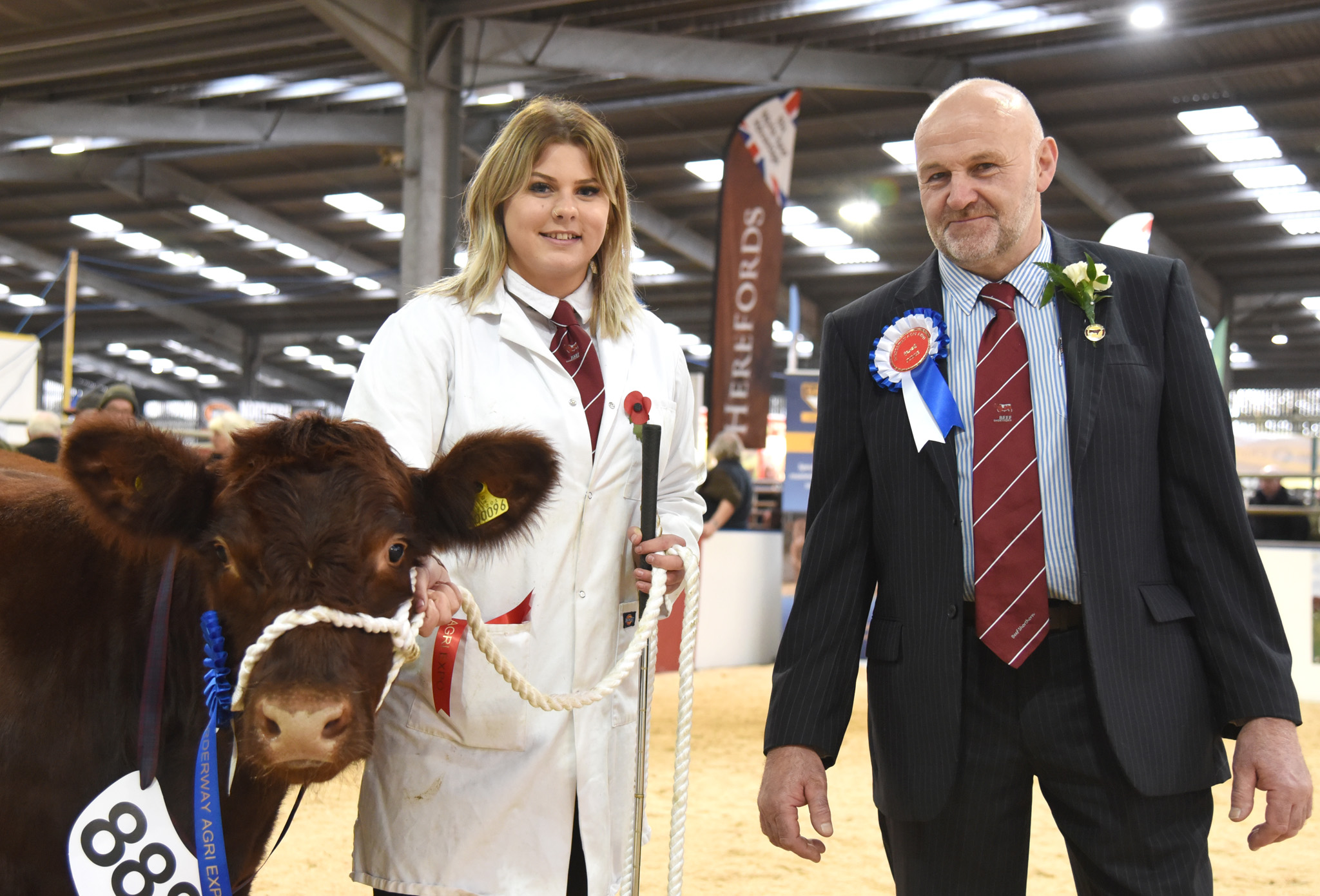 Winner of the Young Handler Class - Erika Ivinson with judge Ian Park.jpg