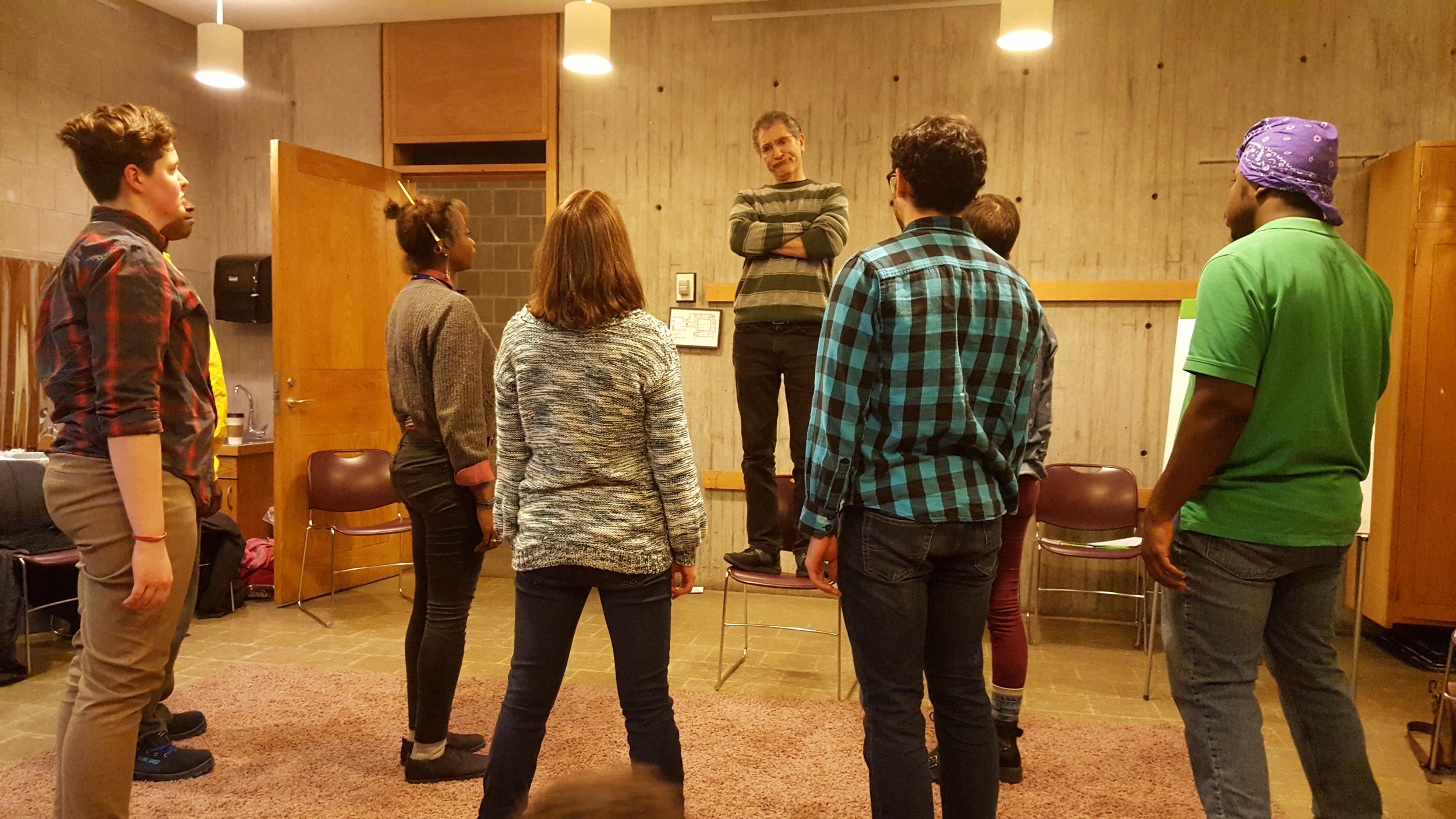 "Impact performance educators in rehearsal, using Image Theatre to explore the topic of ""Diversity & Inculsion in the Workplace."""