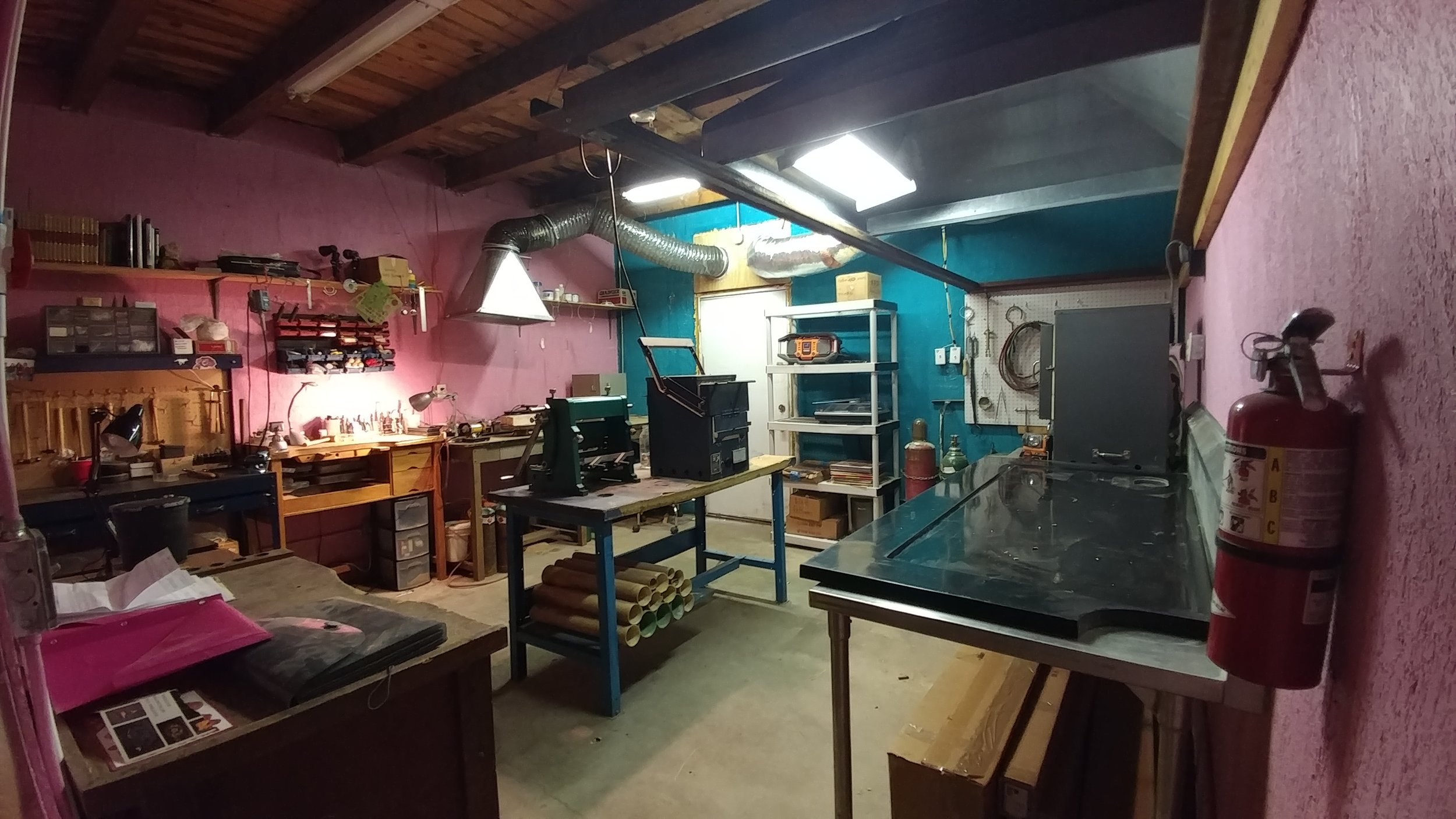 My Studio - Equipped with a lifetime's collection of purchased and inherited tools and machines dedicated to lampwork, metalsmithing, and lapidary. For the first time, I have a studio space to myself organized my way. While I work, I listen to a rotating collection of borrowed records from friends and family on a gifted record player or tune in to the local