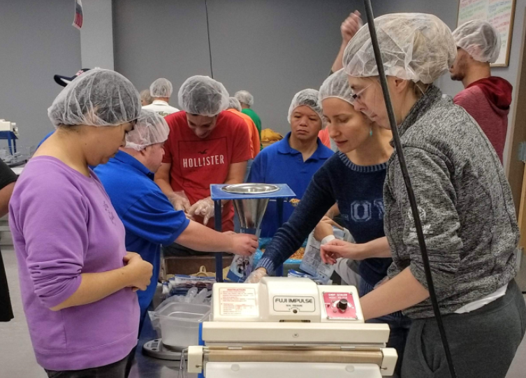 Feed My Starving Children volunteers 2.png