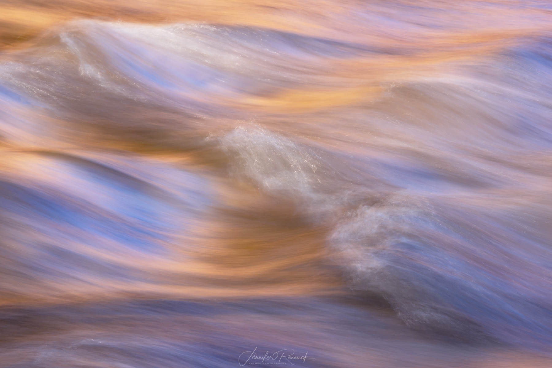 Brushed / Jennifer Renwick / A slower shutter speed captures the colors and textures of the creek, the blue from the sky, and the orange from the reflected canyon light