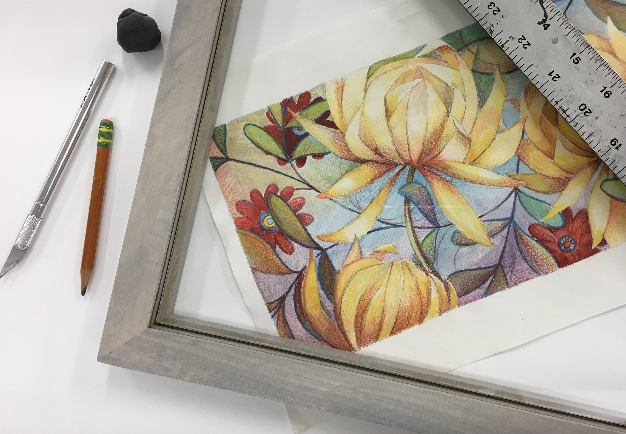 Framing a drawing for my recent Open House. I was motivated to get a lot of my art hung and sell some too!