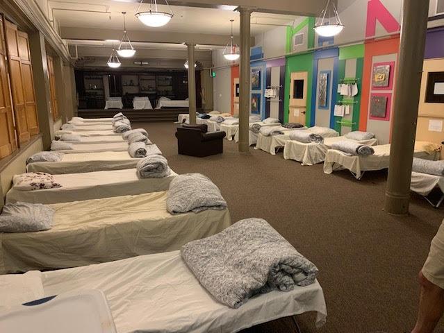 Beds awaiting arrivals at Casa del Paz, a Denver non-profit helping migrants.