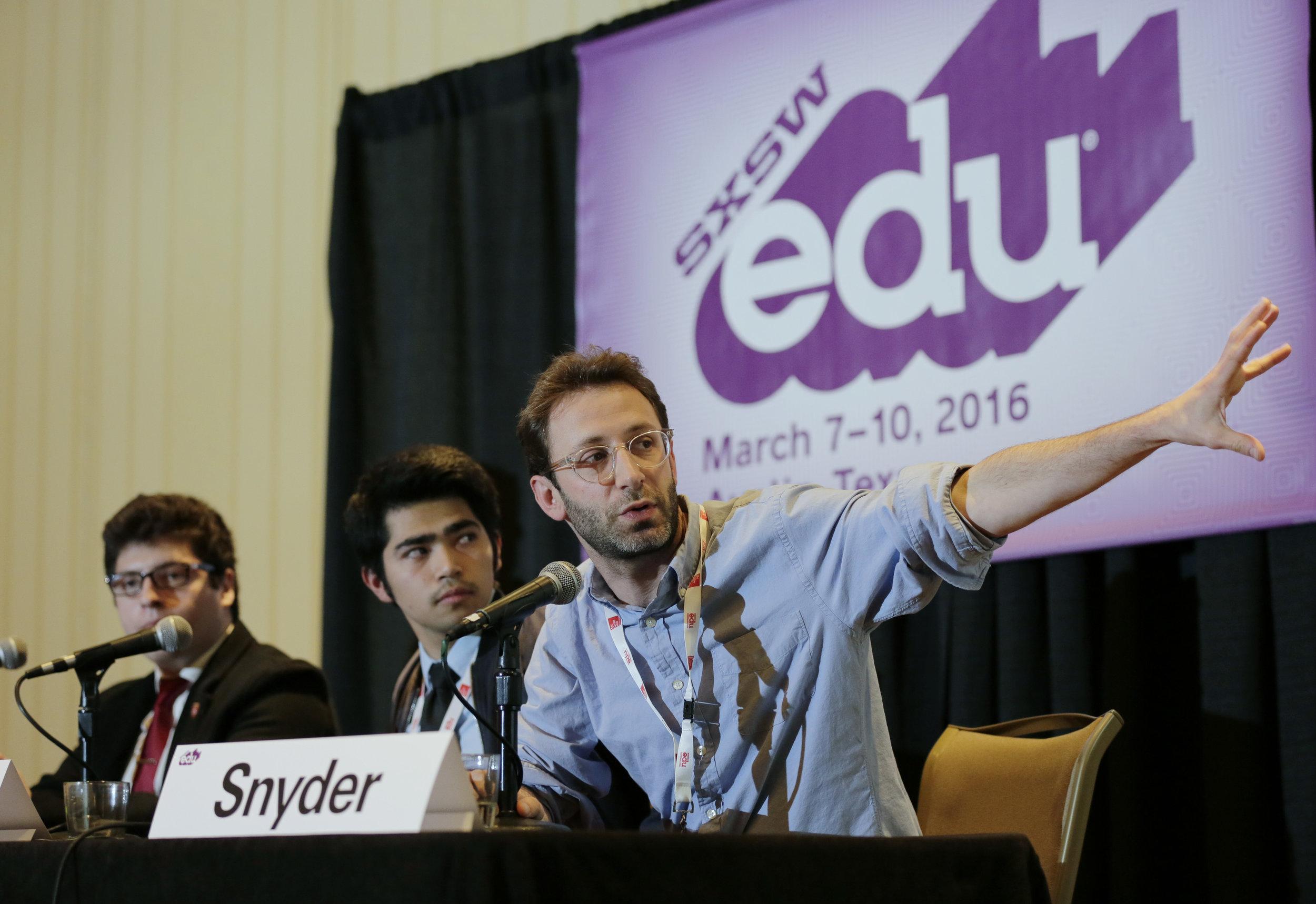 Mr. Snyder with APB alumni speaking at SXSWedu in 2016.