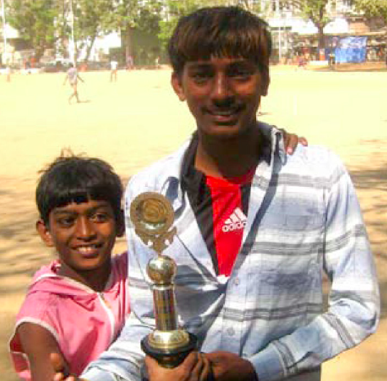 """Shankar studied until the fifth standard when the need to earn income for his family forced him to quit school and work. But selling balloons at traffic junctions did not bring in enough money, and like many of his peers from """"Criminal Tribes"""", Shankar slipped into petty crime. At fourteen, Shankar, elected an Ashoka Youth Venturer, developed a series of cricket tournaments for young people from his community in his Bombay slum area. To bridge generations-old hostility between his community and the police, he systematically invited officers to the games."""