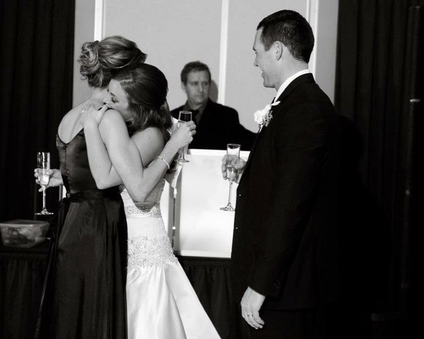 maid of honor toast with bride and groom