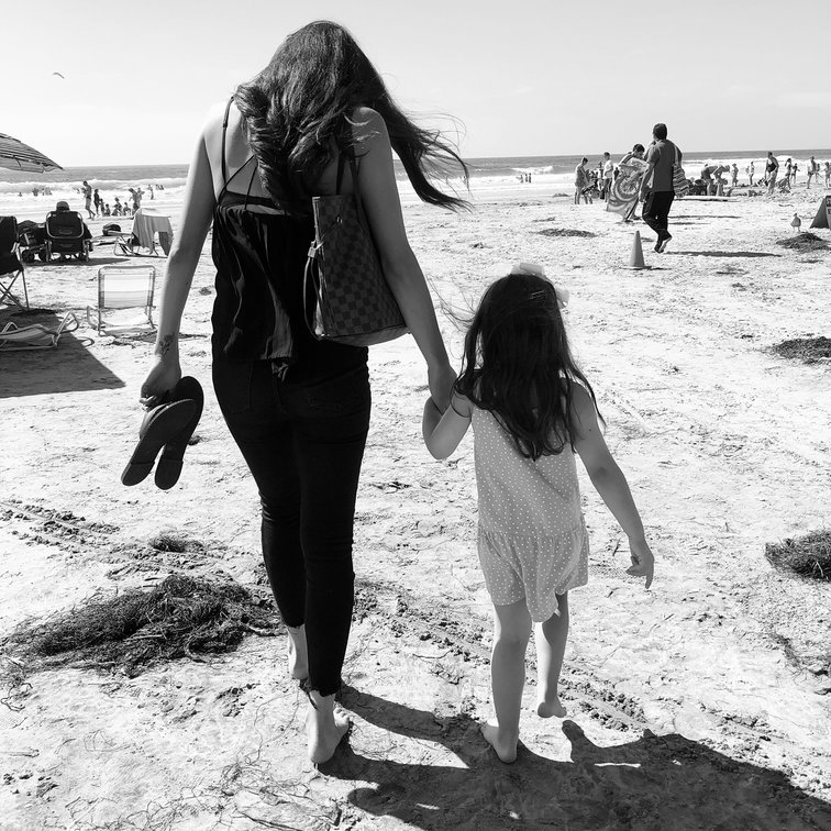 two girls walking on the beach