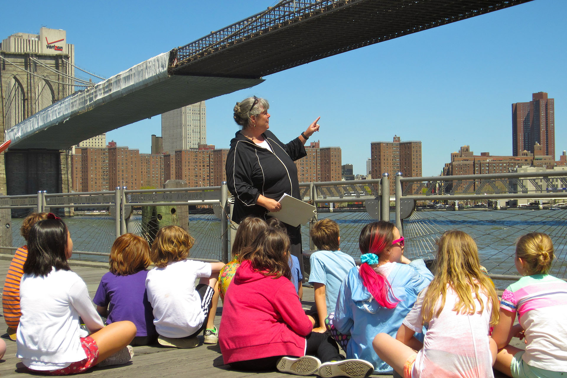 Sarah Richards teaching her fifth graders under the Brooklyn Bridge.