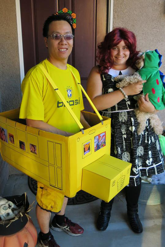 DJ playing Ms. Frizzle and the magic school bus (along with her husband Roee Fung and their dog Kai) to spark science joy
