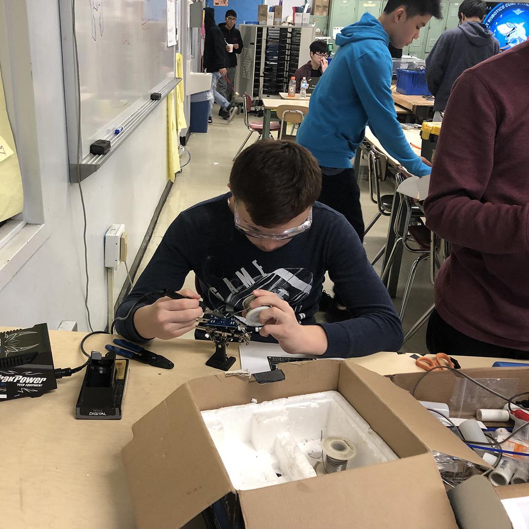 Doniyor Ismatilloev soldering control board components at John Dewey High School. Thanks Team 333 Megalodons