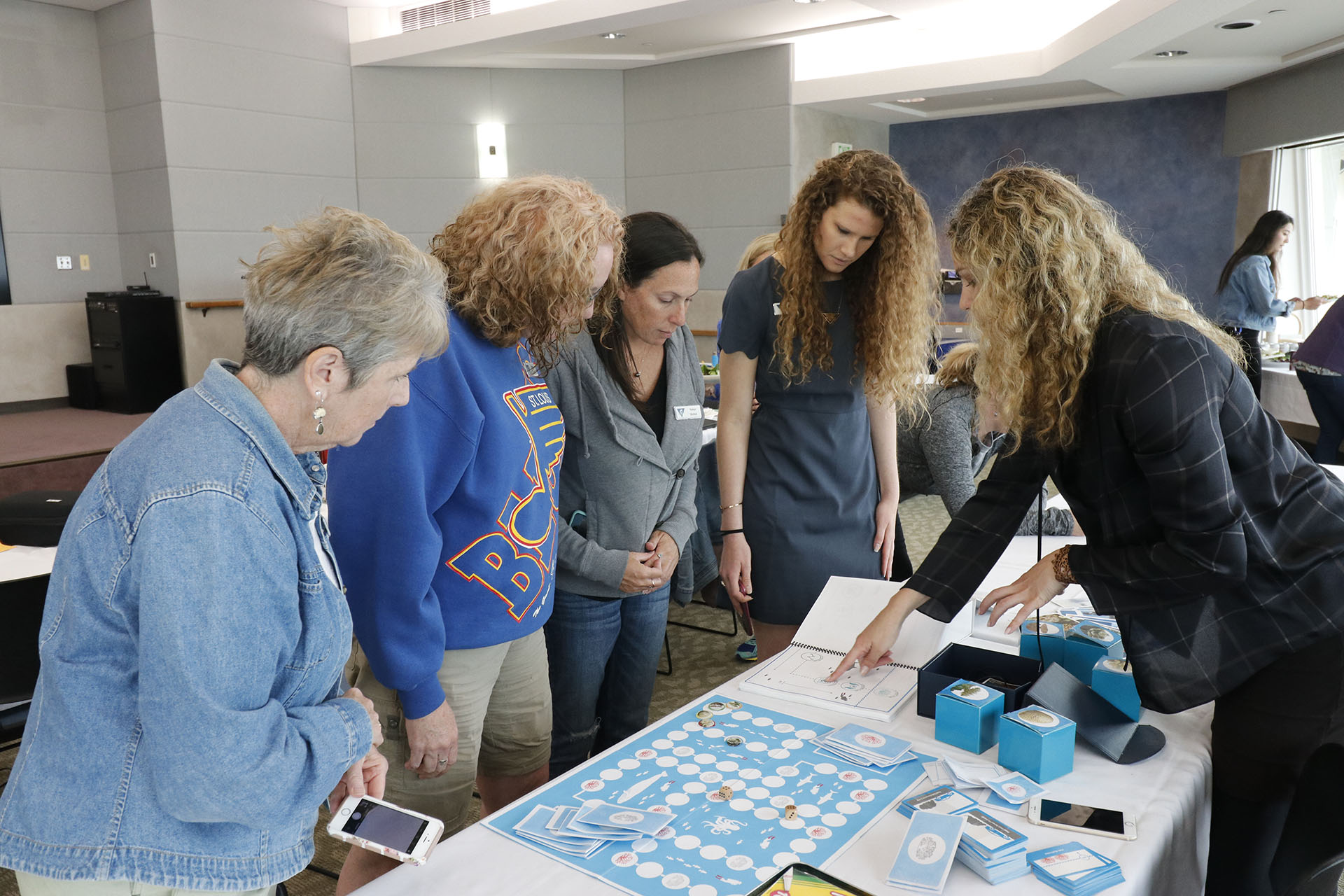 Erika Woolsey demonstrates educational materials developed by The Hydrous to workshop participants