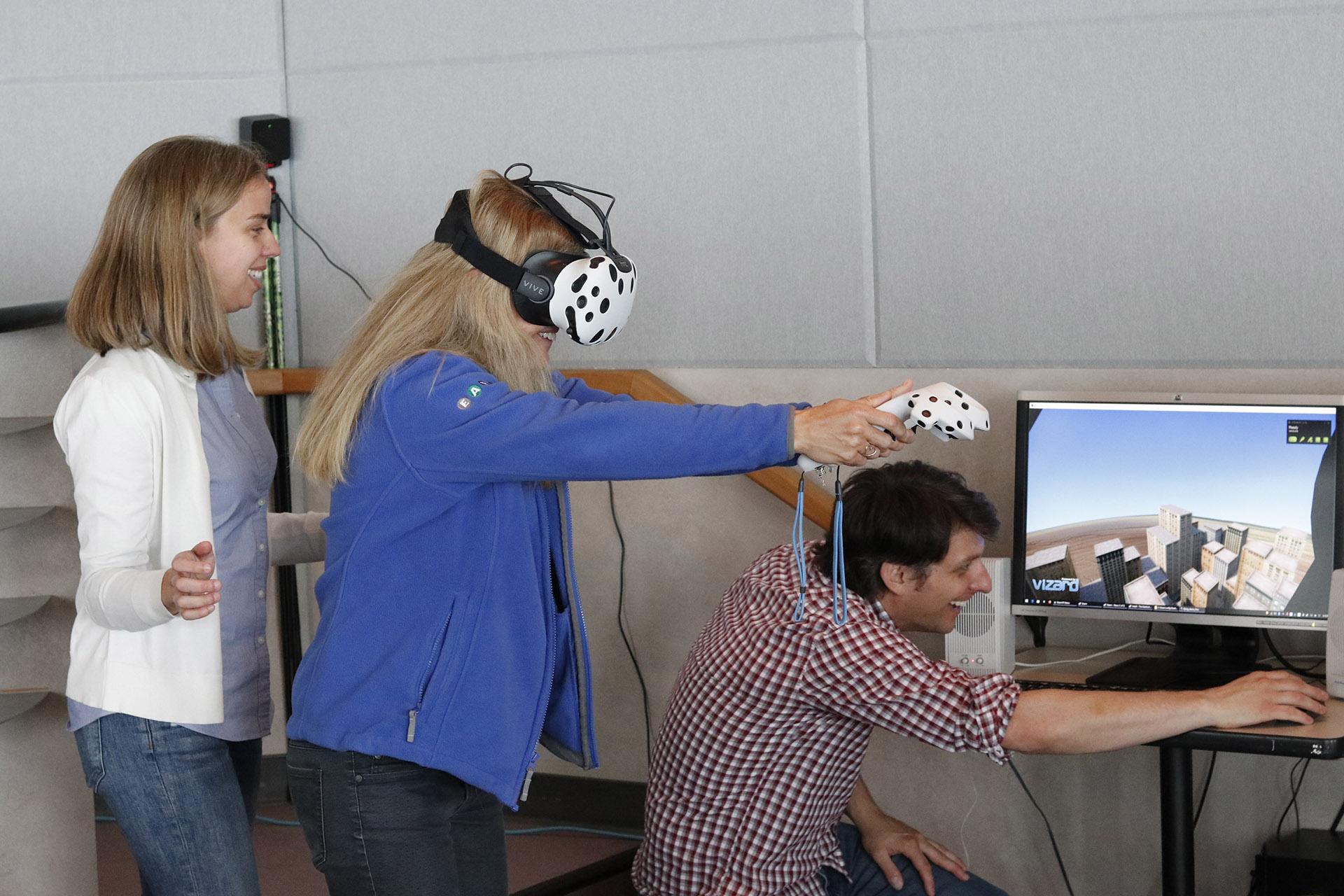 Géraldine Fauville guides Megan McCall through a Superhero VR simulation