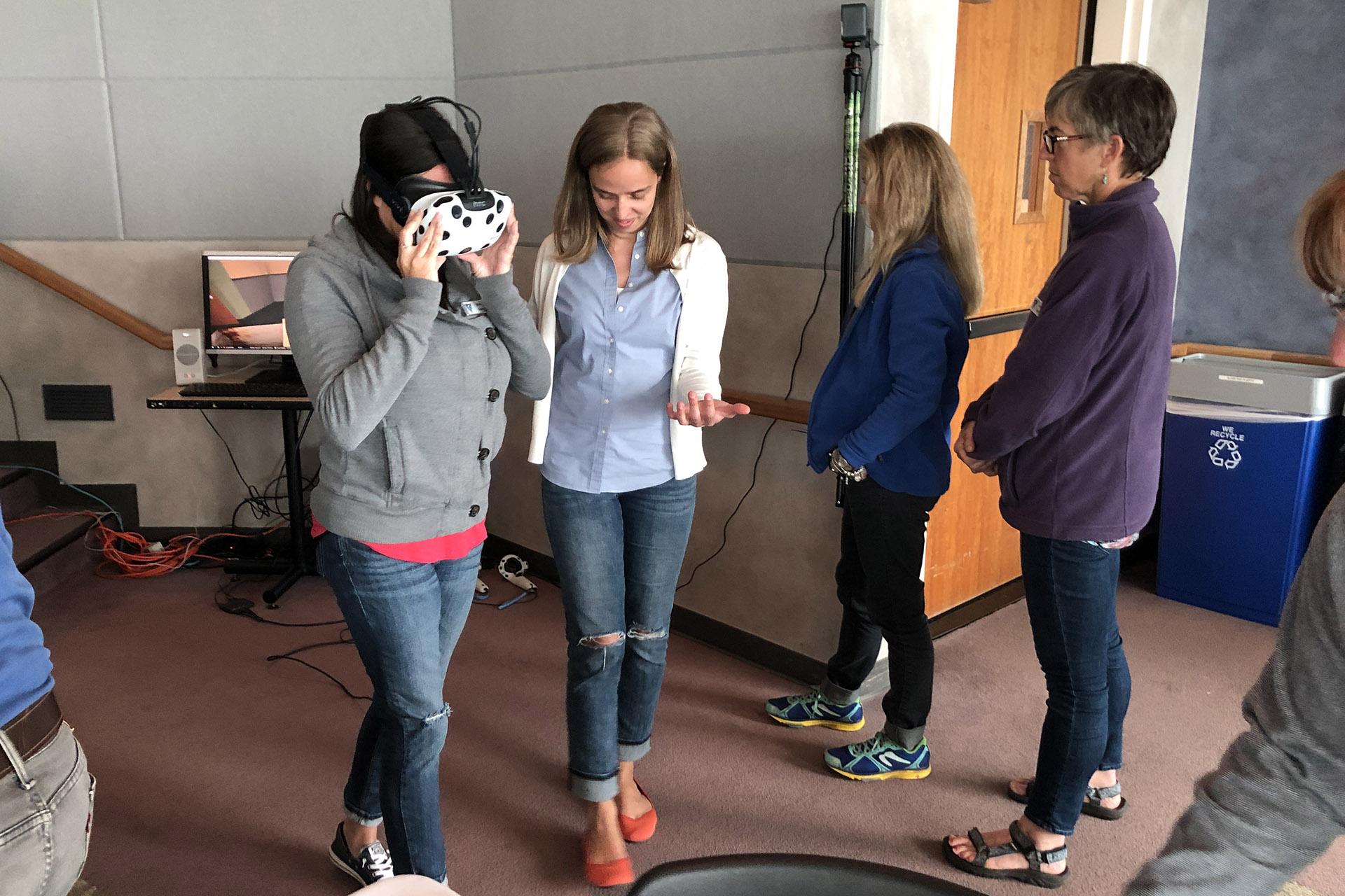 Robyn Ehrlich carefully walks across a virtual pit