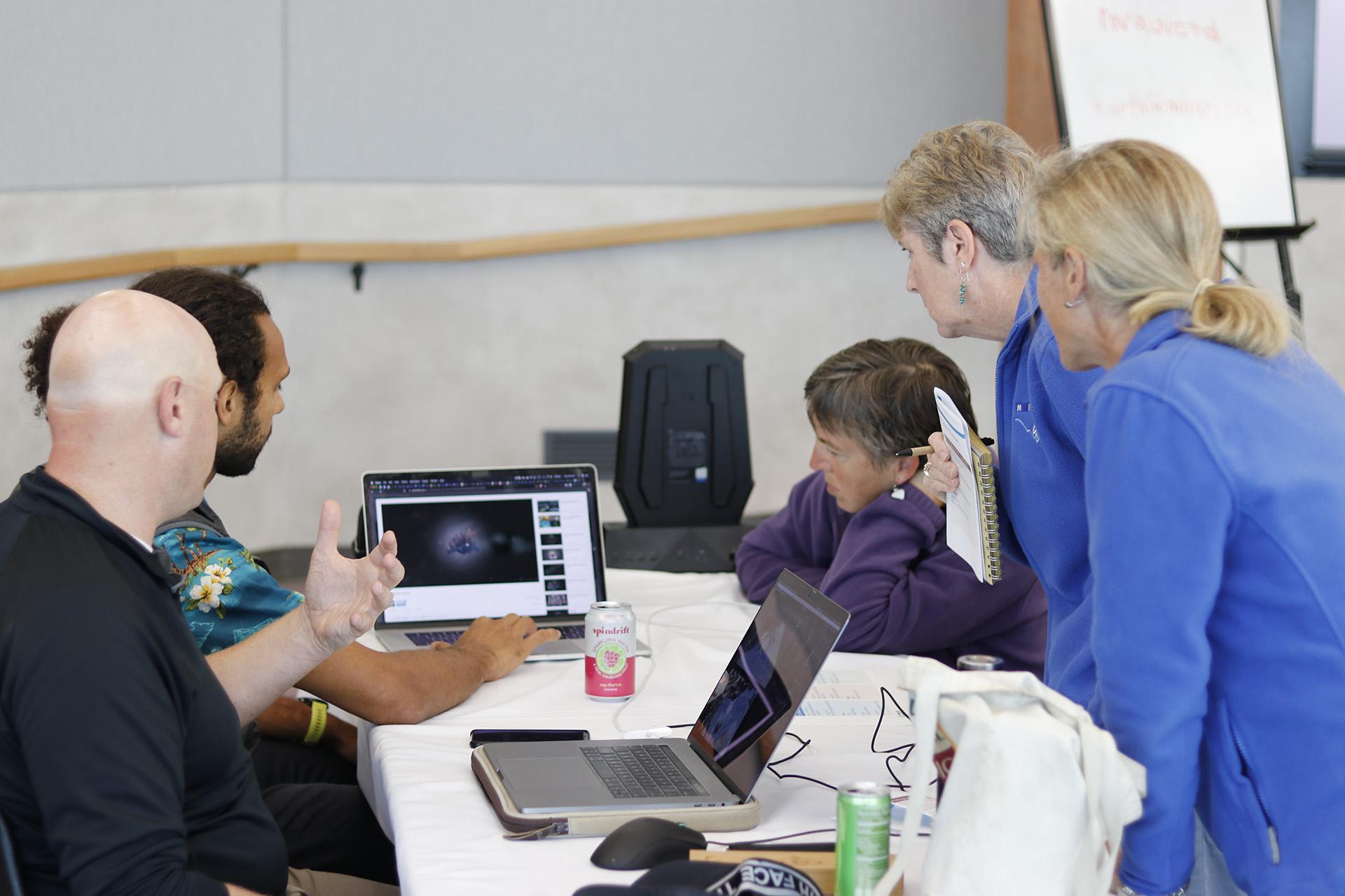 Adam Merry and Craig Mink explore 3D visualization tools with workshop participants