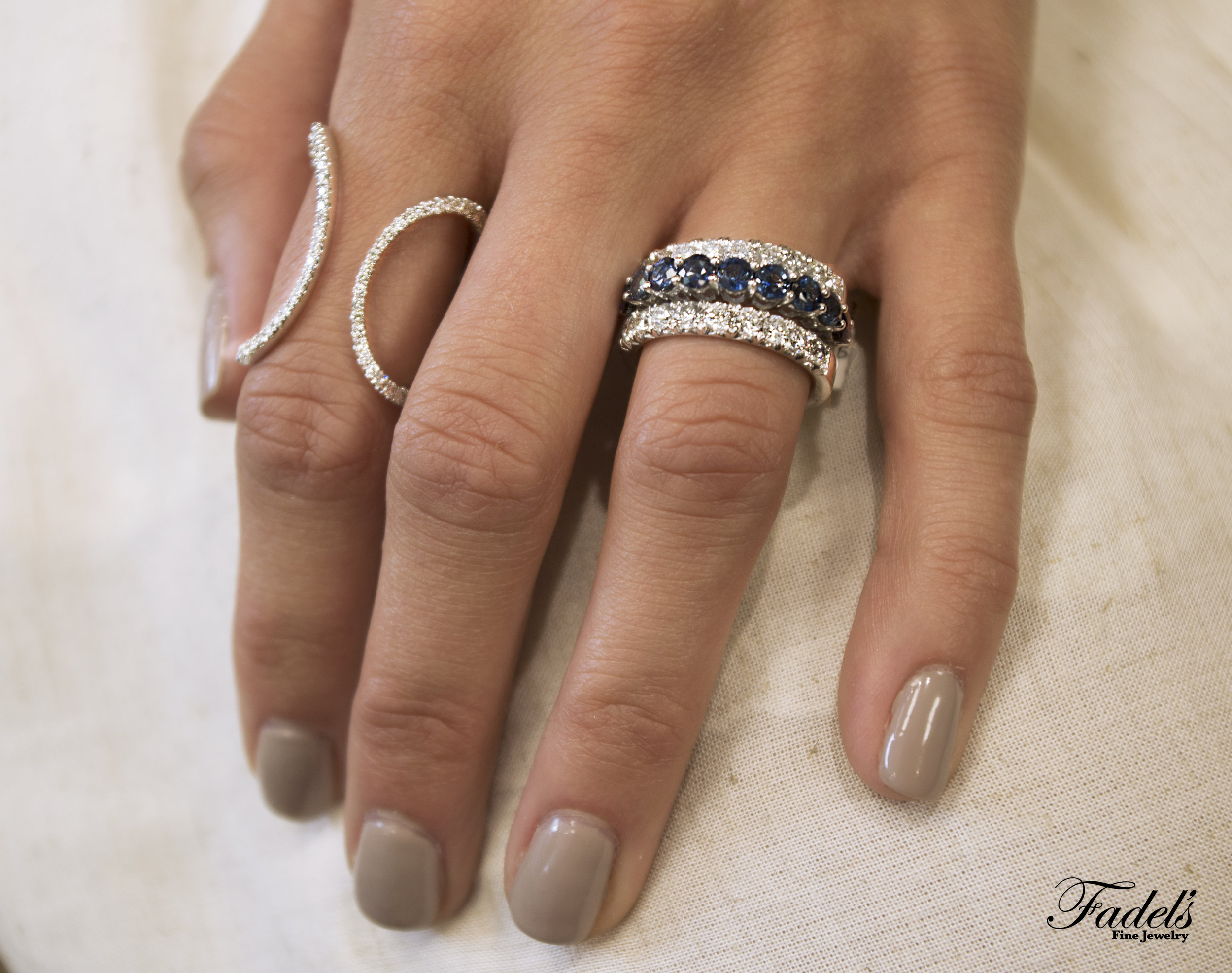 Modern Dia ring. Blue Sapphire Band stacked between to twin diamond bands.JPG