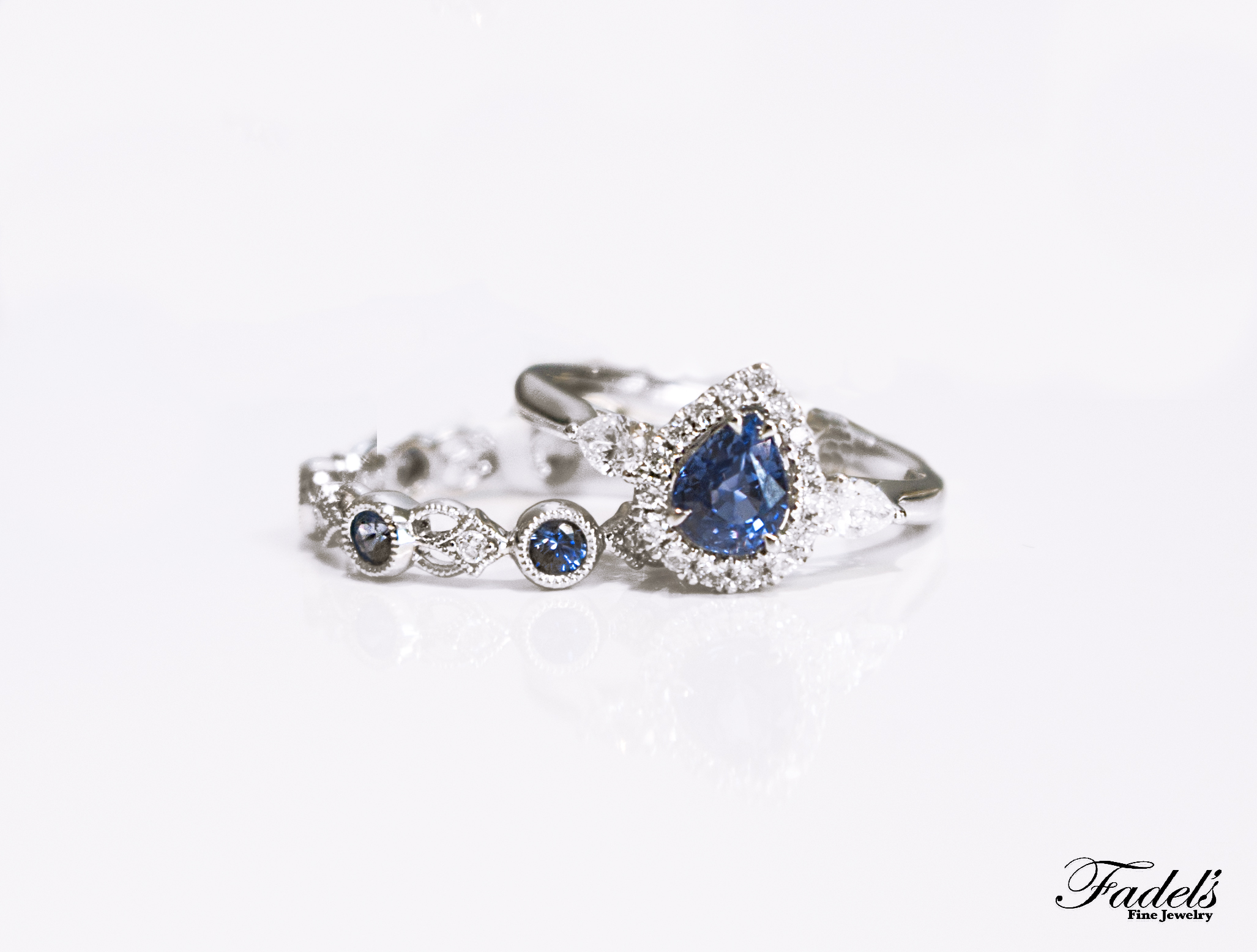 Pear shape Sapphire in Halo setting with Sapphire and Dia Band.JPG