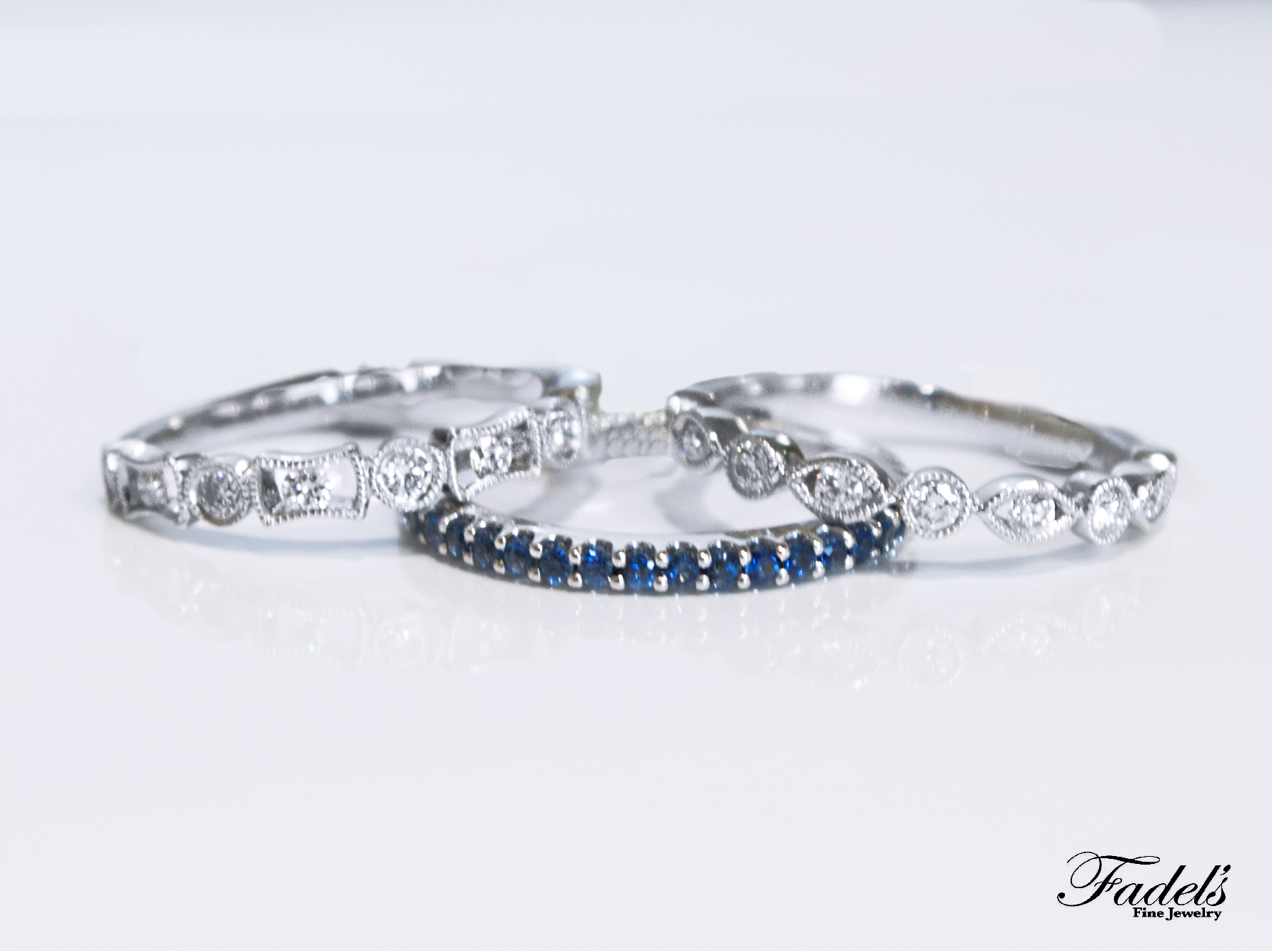 Two Diamond bands with one sapphire band.JPG