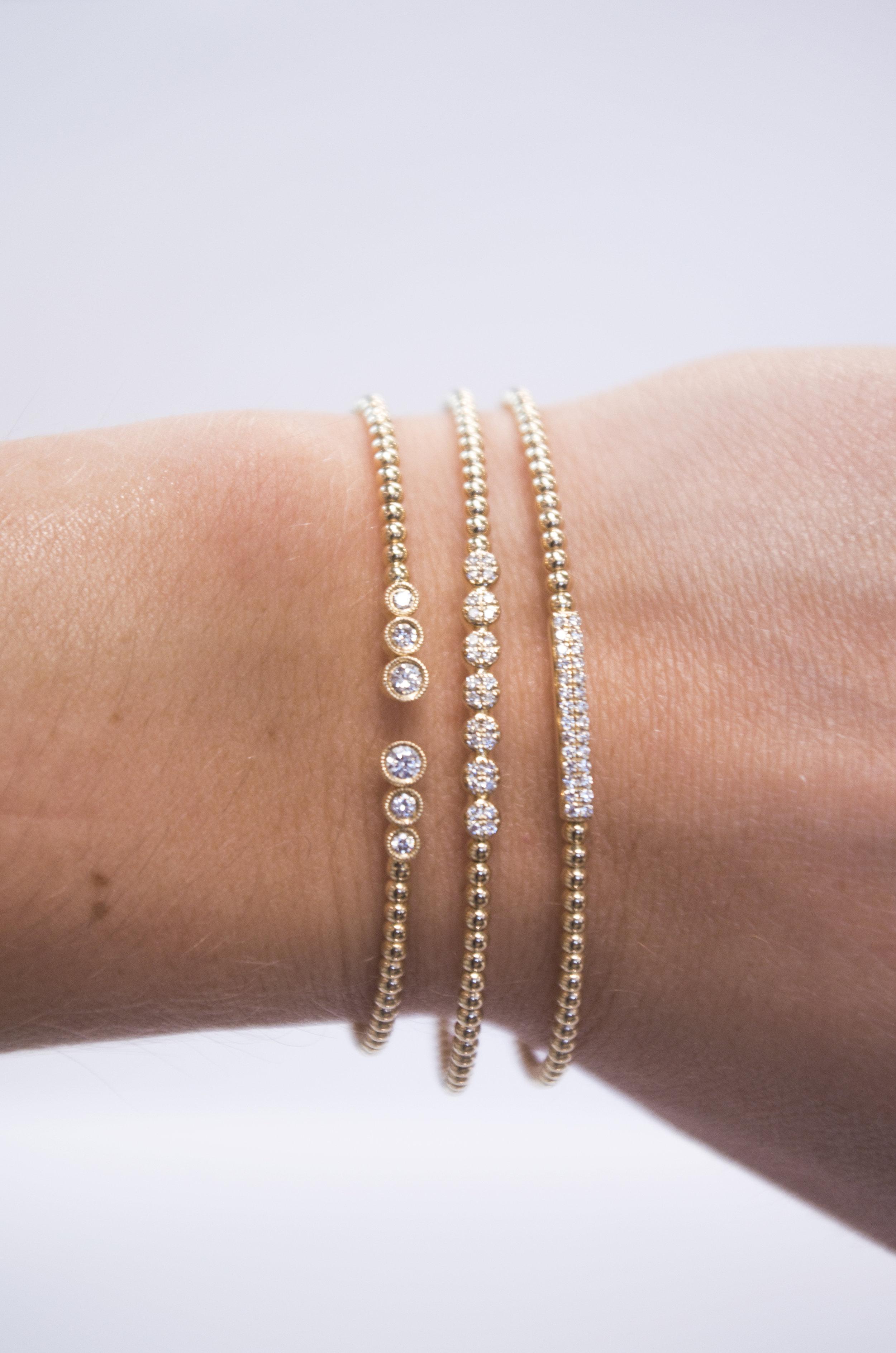 Gabriel Stackable Diamond and gold bracelets.JPG