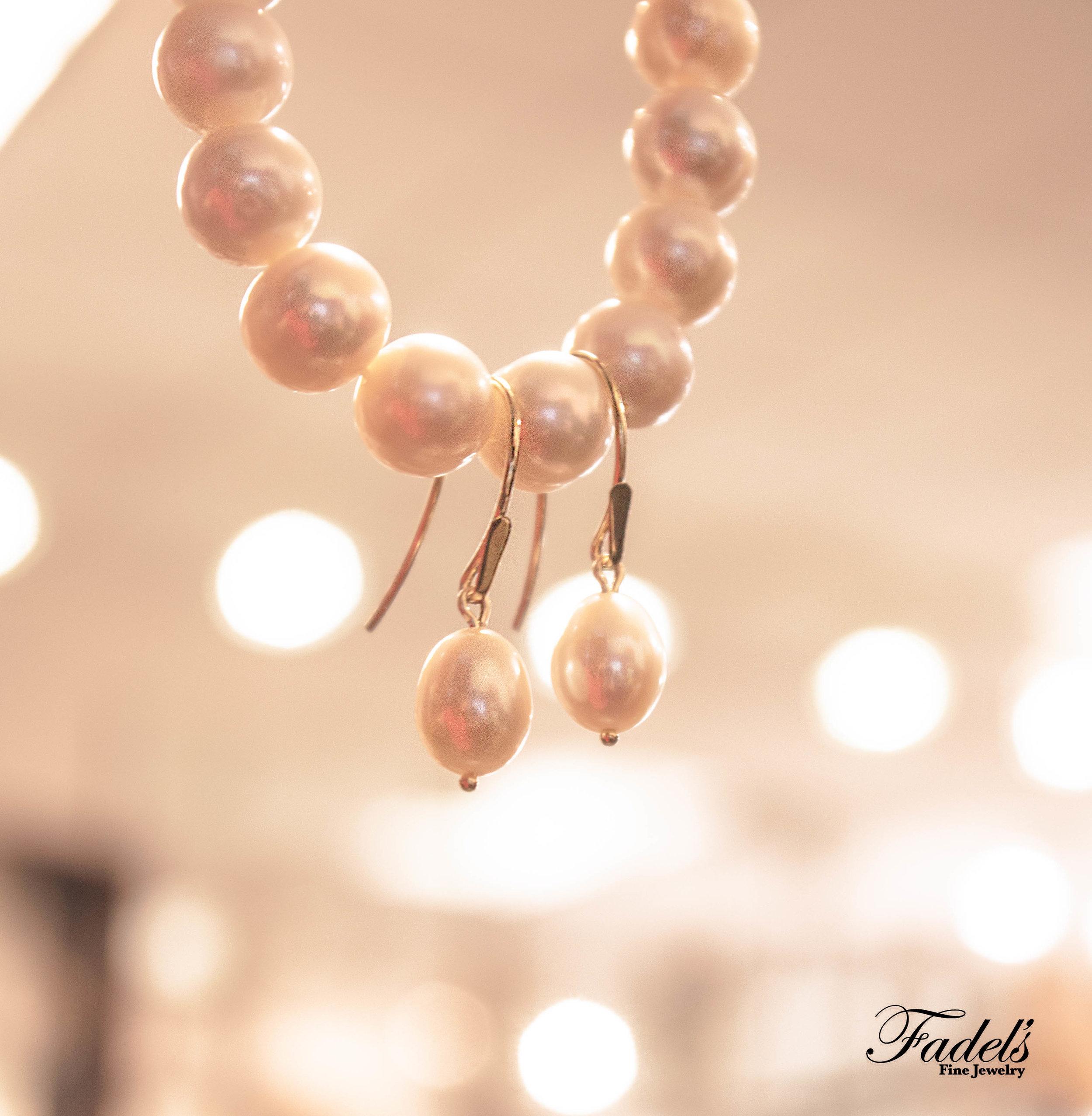 Pearl dangling earrings on pearl bracelet.JPG
