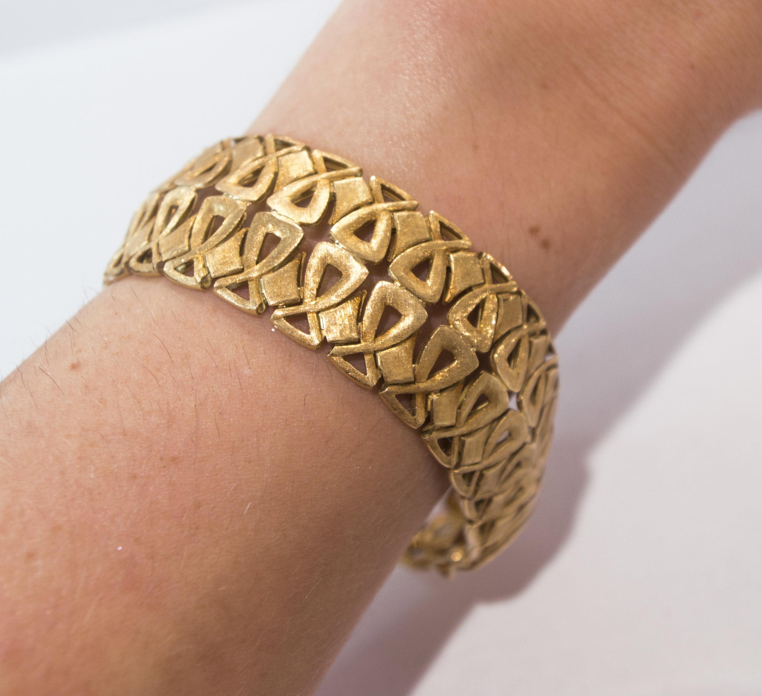 18k yellow gold bracelet on.JPG