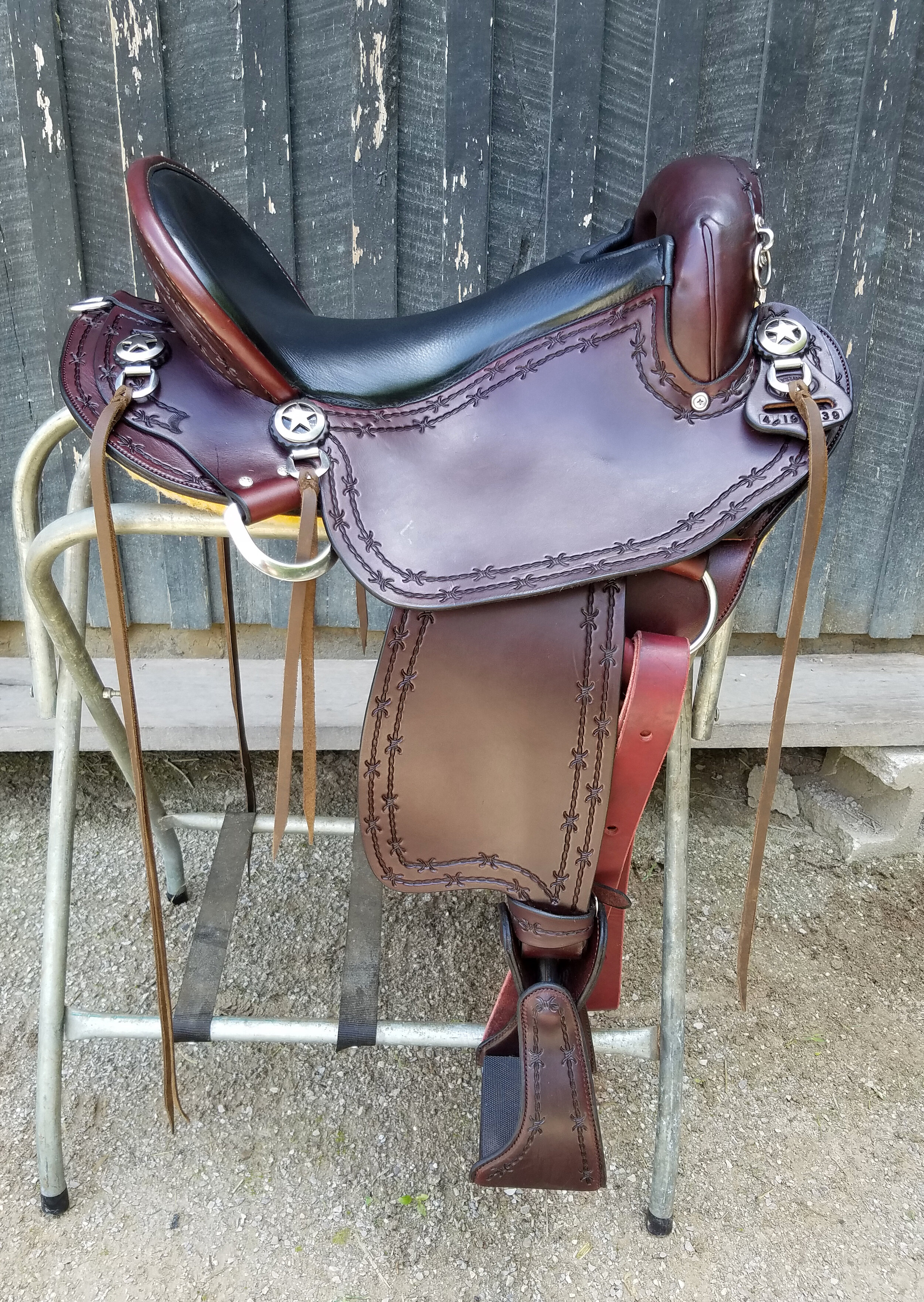 "Eli Miller Custom Endurance Saddle - This 16"" saddle is super lightweight and ultra comfortable. It features a suspended seat which is like riding on air. The Batie tree has 7 degree more flare to the bars, allowing your horse to move and collect easier. The stirrup bars are ground smooth which enables your leg to move freely, much less restriction than many western saddles. Stirrup turners ease the pressure on your knees on those long, hard rides. Padded comfort stirrups complete the package."