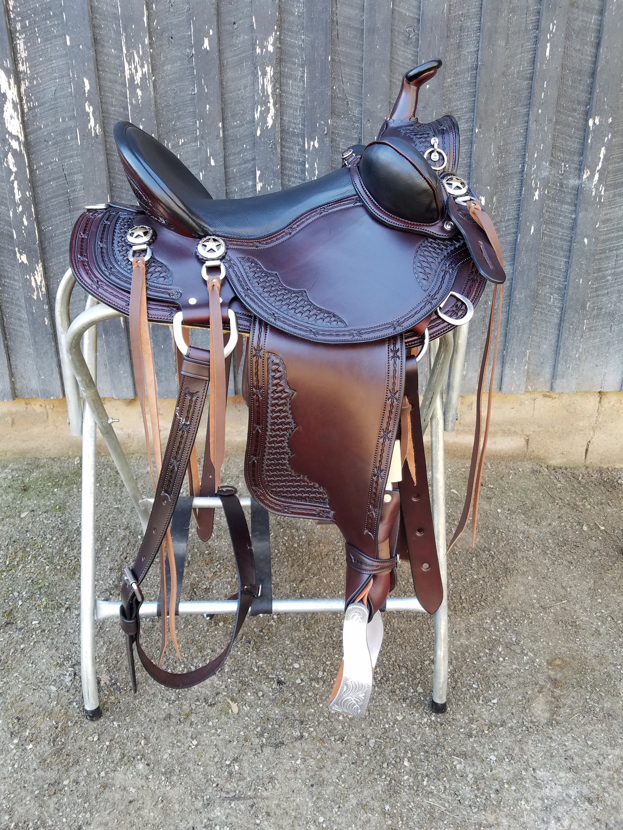"15"" Custom Old Timer by Eli Miller - Lightweight without losing quality. This saddle has a suspended seat that feel like you are riding on air. Bucking rolls help keep you in the saddle and twisted leathers keep your legs and knees in alignment. Texas stars complete the look."