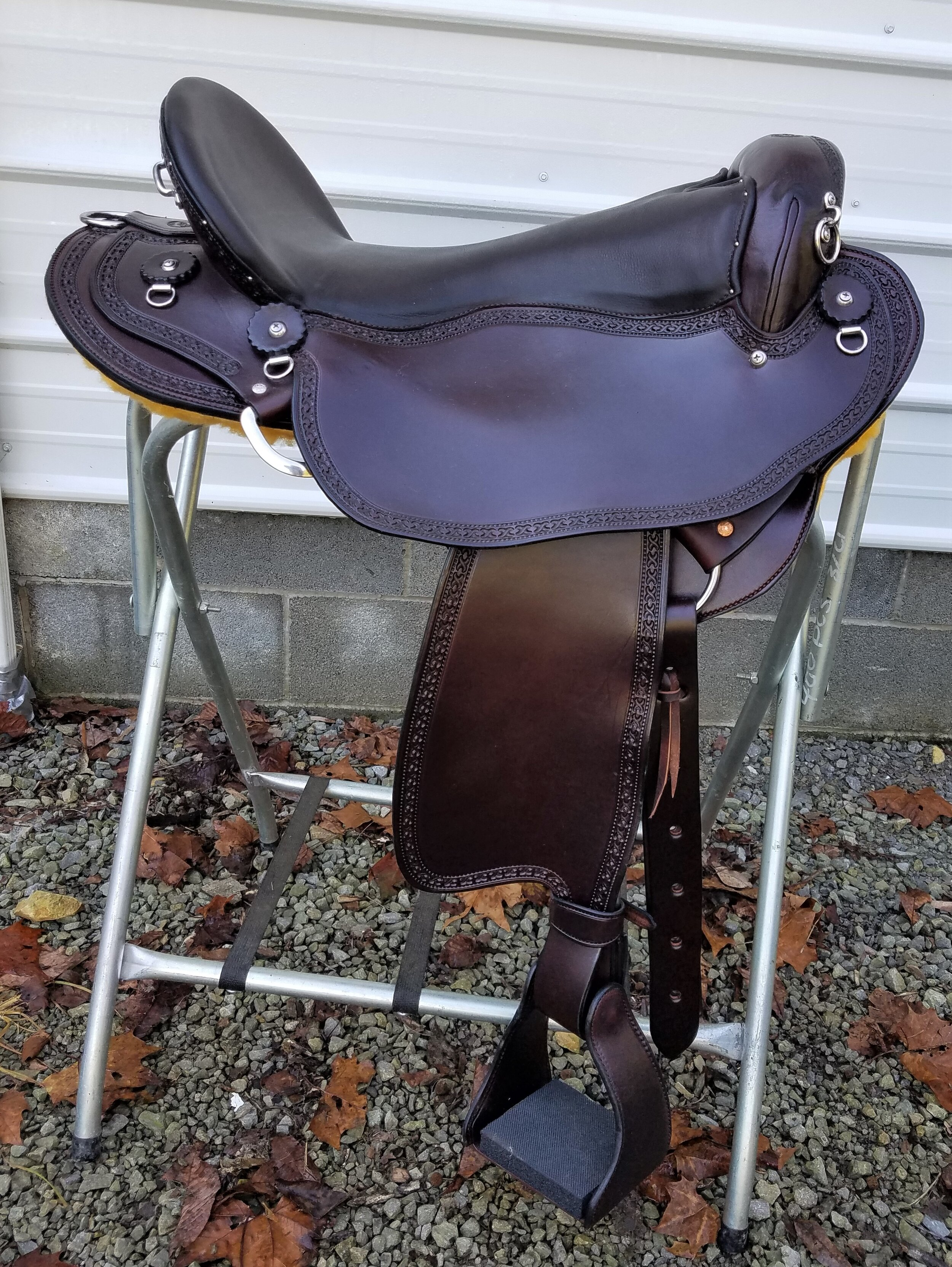 "17"" Custom Endurance Saddle by Eli Miller - This saddle is perfect for the endurance or trail rider that need a comfortable and lightweight saddle that fits the horse and rider. It features a suspended seat and comfort stirrups with just the tooling on the borders to offer easy care and cleaning."