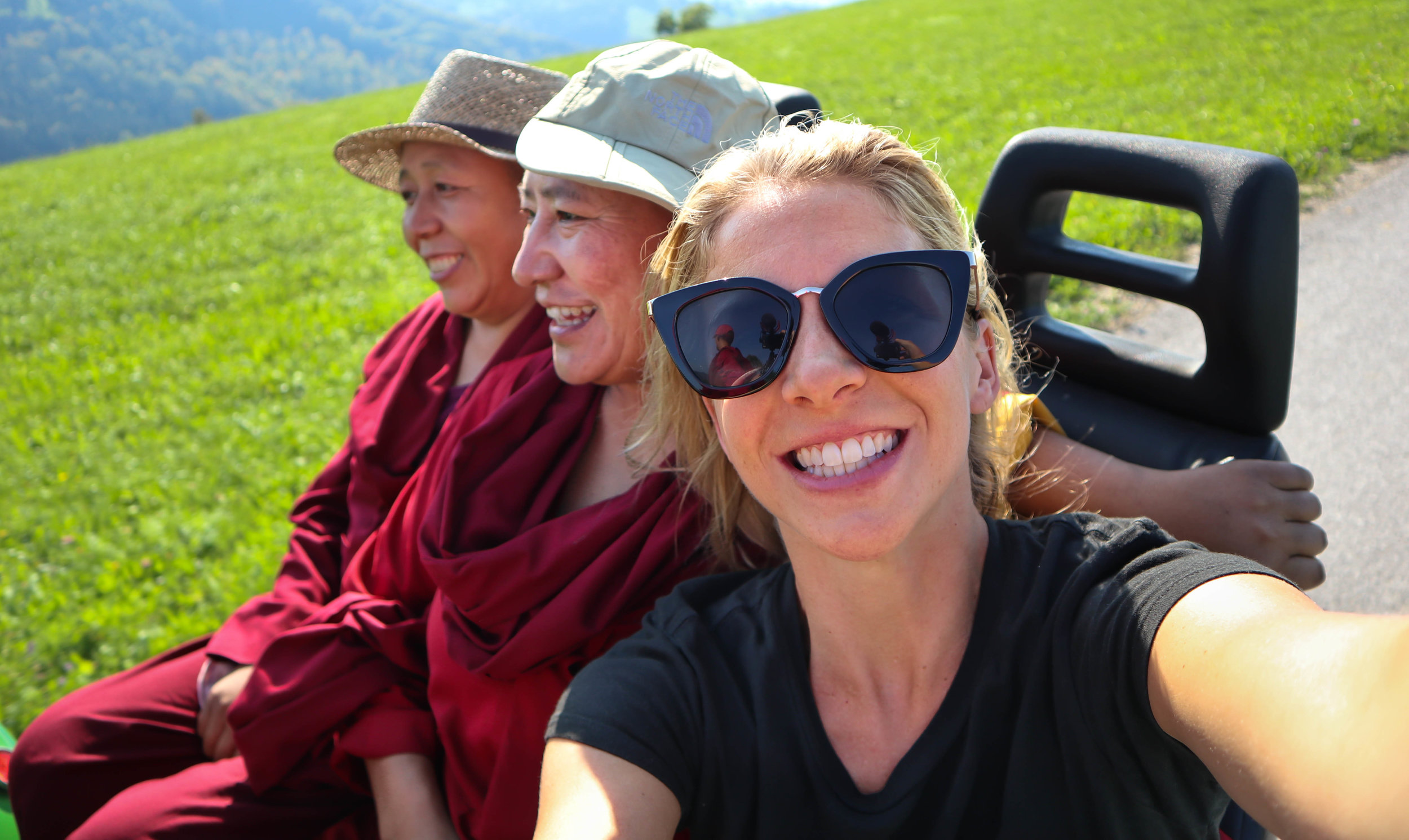 Riding a tractor with Buddhist nuns from Nepal .