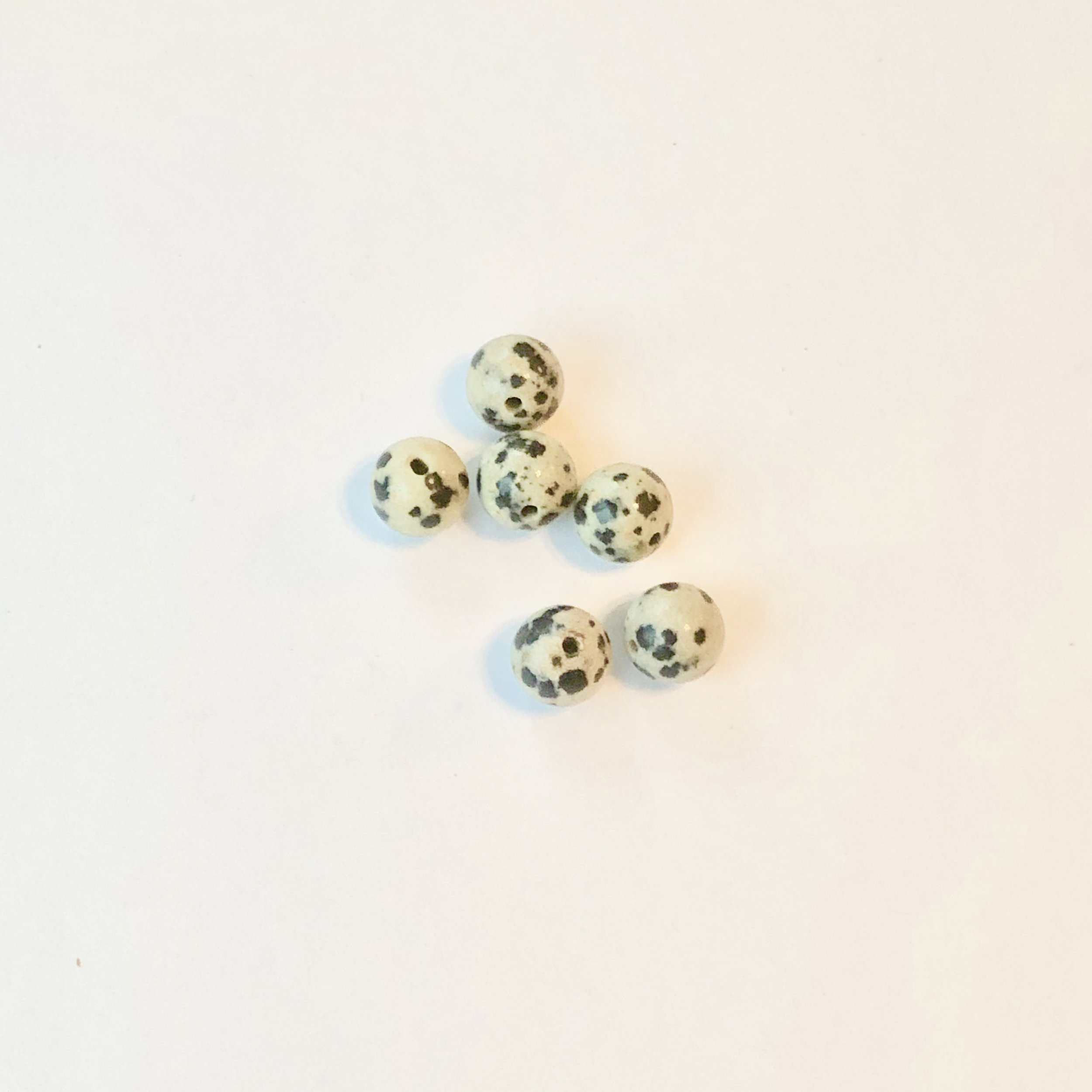 Dalmatian Jasper: Encourages playfulness. Fortifying, Encourages fidelity and emotional balance.