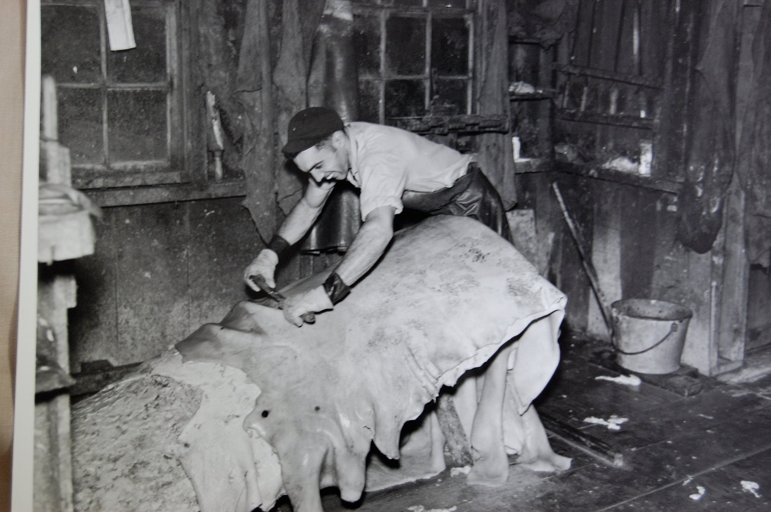 guy-scrapping-hides-1940s.jpg